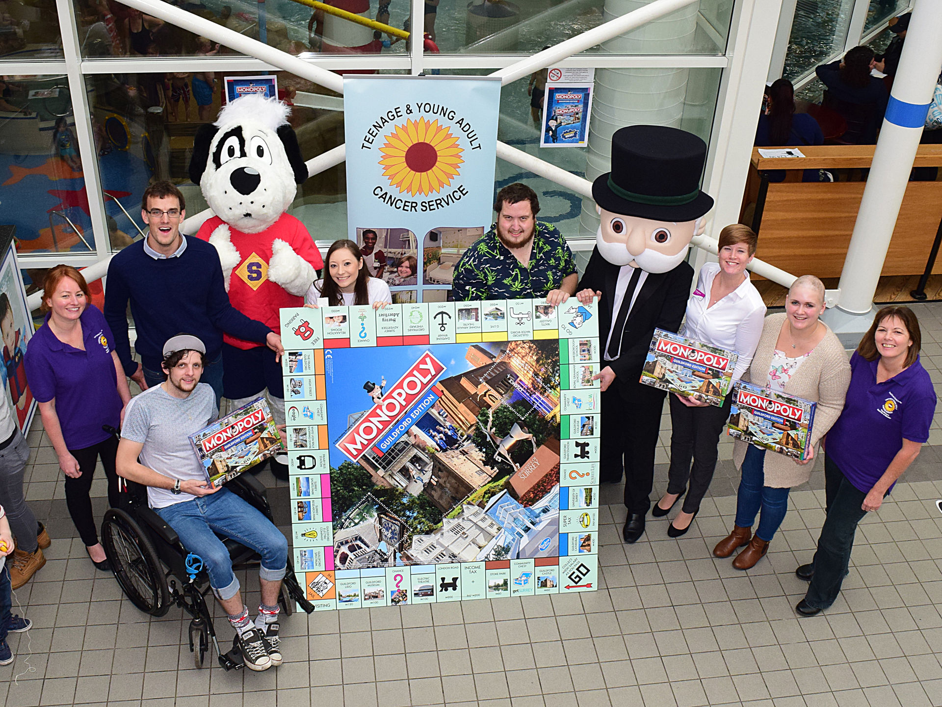 Spectrum presents charity of the year with Guildford Monopoly Board